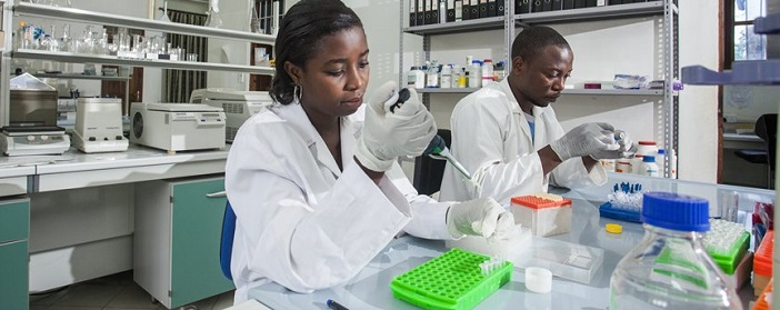Lab techs conducting mosquito research in Tanzania.